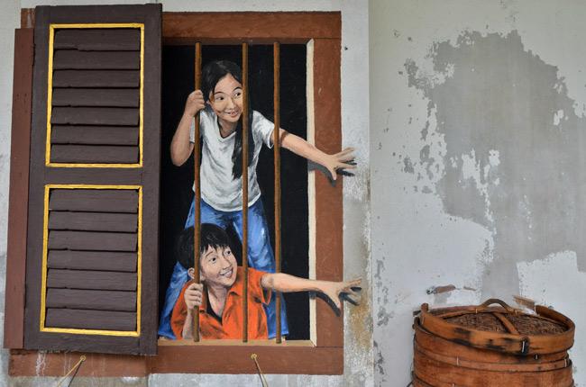 Niños dibujados en la pared, Street Art (Penang, Malasia)